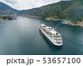Aerial view of luxury medium cruise ship sailing to port through the bay 53657100