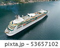 Aerial view of luxury medium cruise ship sailing to port through the bay 53657102