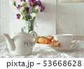 Morning breakfast rustic still life. Tea cup croissant with cream, flowers in vase. Vintage rural 53668628