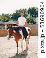 Elegant girl in a farm wiith a horse 53690904