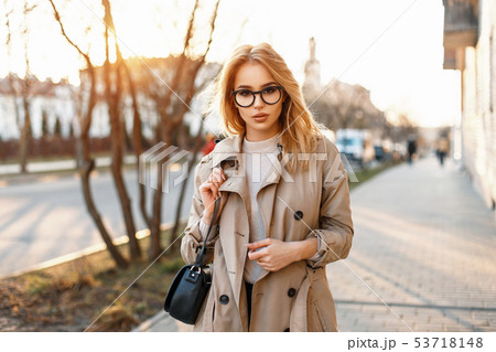 Beautiful young hipster girl with sunglasses 53718148