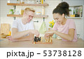 Young blonde man is playing chess with african american young woman 53738128