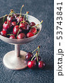 Fresh cherries in vintage silver vase 53743841