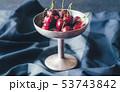 Fresh cherries in vintage silver vase 53743842