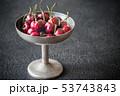 Fresh cherries in vintage silver vase 53743843