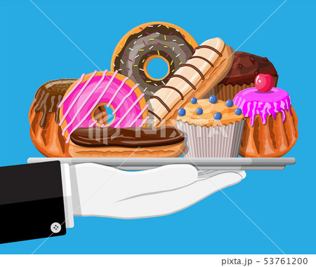 Sweet desserts in tray in hand. 53761200