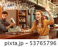 Cheerful beautiful red-haired laughing bar visitor emotionally waving to someone 53765796