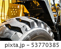 large tires with deep treads mounted on a tractor  53770385