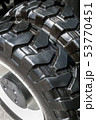 large tires with deep treads mounted on a tractor  53770451