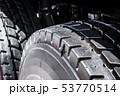 large tires with deep treads mounted on a tractor  53770514
