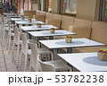 Modern cozy outdoor cafe with small tables 53782238
