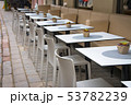 Modern cozy outdoor cafe with small tables 53782239