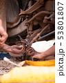 Hands of mechanic fixing wishbone control arm of 53801807