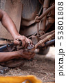 Hands of mechanic fixing wishbone control arm of 53801808