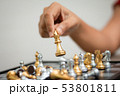 Hand of woman playing chess for business tactic 53801811