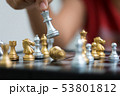 Hand of woman playing chess for business tactic 53801812