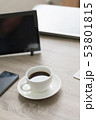 Coffee cup on wooden table with tablet laptop 53801815
