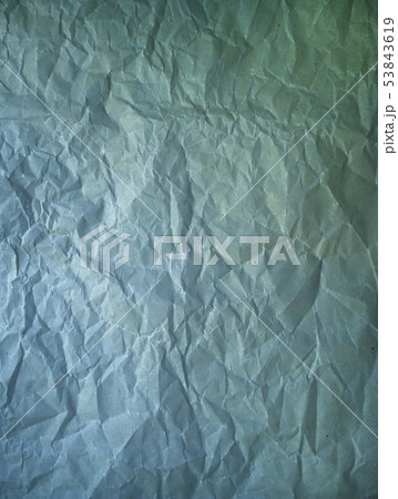 Old crumpled paper vintage texture. Rough wrinkled dark green blue color shadows sheet. Textured 53843619