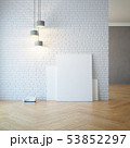 empty room with light and blank pictures 53852297