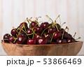 dark red ripe sweet cherry close up 53866469