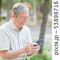 携帯電話 携帯 人の写真 53898716