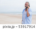 Senior single man talking on calling summer beach 53917914