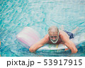 Lonely elder, Old man swimming at pool alone  53917915