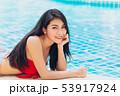 Happy bikini asian girl teen smile enjoy pool 53917924