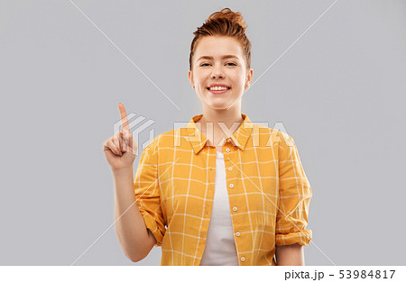 red haired teenage girl showing one finger 53984817
