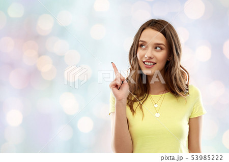 young woman or teenage girl pointing finger up 53985222