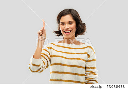 happy woman showing one finger or pointing up 53986438