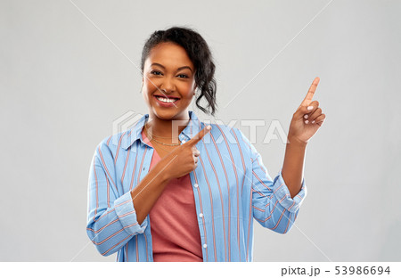 happy african american woman pointing finger up 53986694