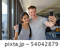 Portrait of young multi-ethnic couple enjoying vacation together 54042879