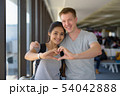 Portrait of young multi-ethnic couple enjoying vacation together 54042888