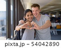 Portrait of young multi-ethnic couple enjoying vacation together 54042890