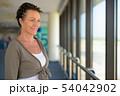 Mature beautiful Scandinavian tourist woman enjoying vacation at 54042902