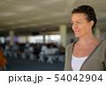 Mature beautiful Scandinavian tourist woman enjoying vacation at 54042904