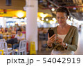 Mature beautiful Scandinavian tourist woman enjoying vacation at 54042919