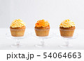 cupcakes with frosting on confectionery stands 54064663