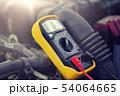 multimeter or voltmeter testing car battery 54064665