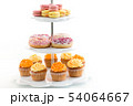 glazed donuts, cupcakes and macarons on stand 54064667