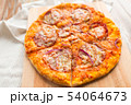 close up of homemade pizza on wooden table 54064673