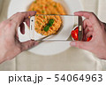 Man taking photo of Red risotto 54064963