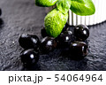 Black olives on black stone 54064964