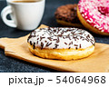 Sweet donuts on black stone table 54064968