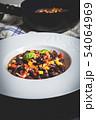 Chili corn carne on stone table 54064969