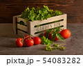 Fresh herbs in wooden box with tomatoes 54083282
