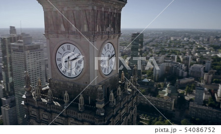 Aerial view of the clock with city coat of arms on historic Palace of Culture and Science in the 54086752