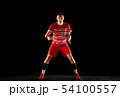Young man playing badminton isolated on black studio background 54100557