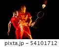 Young man playing badminton isolated on black studio background 54101712
